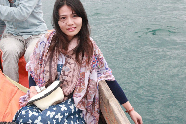 Ariel enjoyed the boating on Lugu River