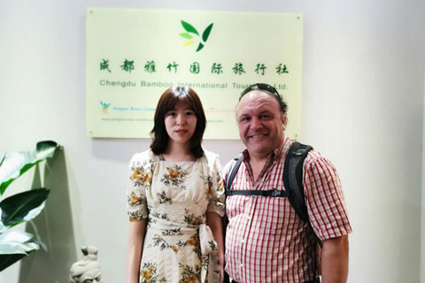 Our client Jose from UK visited our office in Chengdu, photo with his travel consultant Catherine