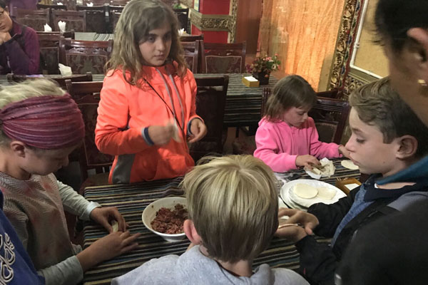 Catherine's liltte customers are learning to make Yak Momo in Tibet
