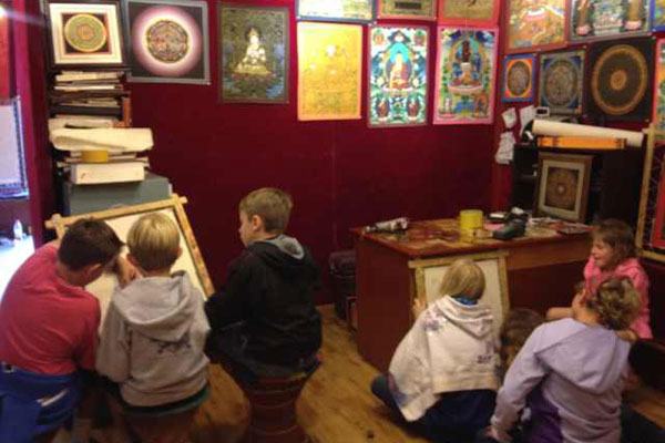 Catherine's liltte customers are learning to make Thangka in Tibet