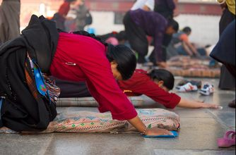 Tibetan Woman Prostrating on Jokhang Temple