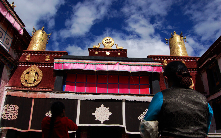 Pilgrims are prostrating in the Jokhang Monastery
