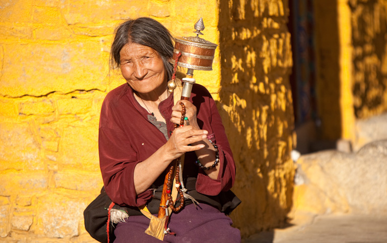 Old Tibetan Lady Welcomes with Smiles
